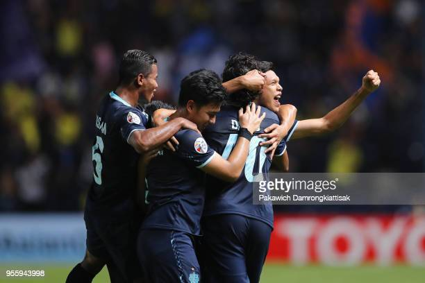 Diogo of Buriram United celebrates scoring his side's second goal with his team mates during the AFC Champions League Round of 16 first leg match...