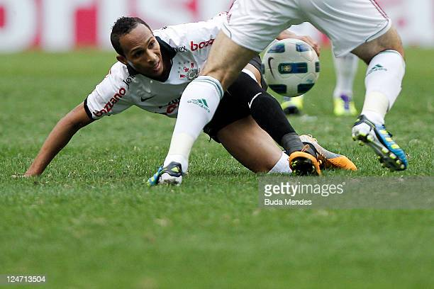 Diogo of Fluminense struggles for the ball with Liedson of Corinthians during a match as part of Serie A 2011 at Engenhao stadium on September 11,...