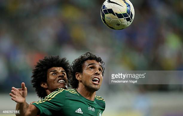 Diogo of Palmeiras fights for the ball with Pascoa of Recife during the match between Palmeiras and Sport Recife for the Brazilian Series A 2014 at...