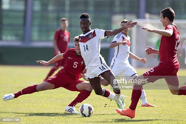 Diogo Queiros and Diogo Dalot of Portugal challenge Gabriel Kyeremateng of Germany during the U16 Algarve Cup match between Germany and Portugal on...