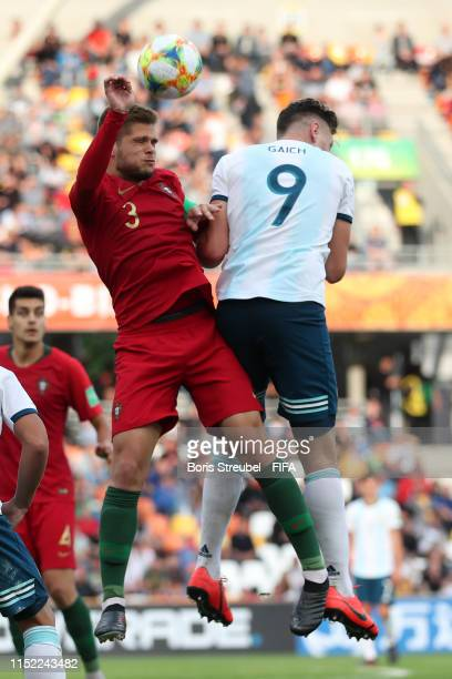 Diogo Queiros of Portugal and Adolfo Gaich of Argentina compete for a header during the 2019 FIFA U20 World Cup group F match between Portugal and...