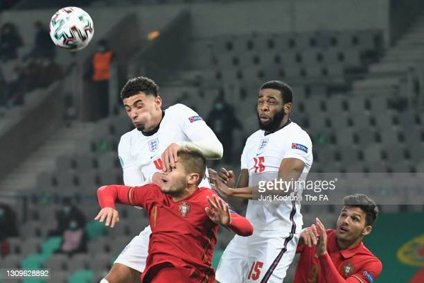 Diogo Queiros of Portugal battles for a header with Ben Godfrey and Japhet Tanganga of England during the 2021 UEFA European Under-21 Championship...