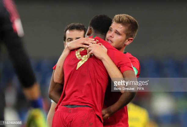 Diogo Queiros of Portugal consoles Rafael Leao of Portugal following their team's draw in the 2019 FIFA U20 World Cup group F match between South...