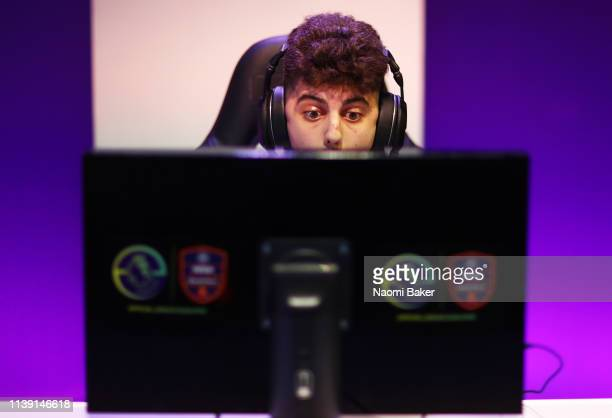 Diogo 'SCP Diogo' Mendes reacts behind his screen during day 2 of the ePremier League Finals 2019 at Gfinity Arena on March 29 2019 in London England