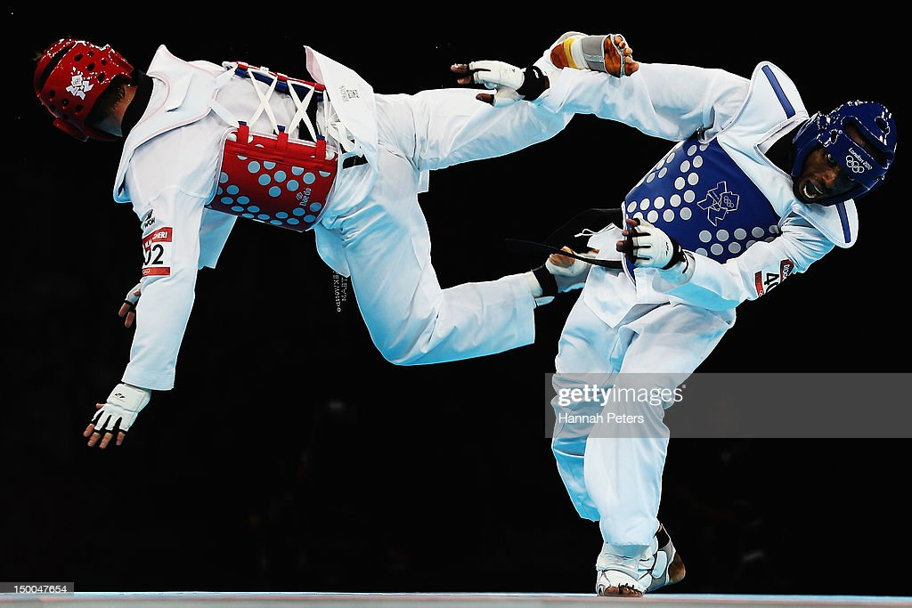 Diogo Silva of Brazil competes against Mohammad Bagheri Motamed of Iran during the Men's -68kg Taekwondo semifinal match on Day 13 of the London 2012 Olympic Games at ExCeL on August 9, 2012 in London, England.
