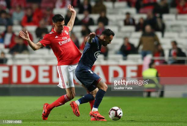 Diogo Viana of Belenenses SAD with Andreas Samaris of SL Benfica in action during the Liga NOS match between SL Benfica and Belenenses SAD at Estadio...