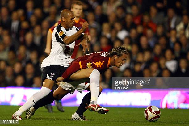 Diomansy Kamara of Fulham battles for the ball with Philippe Mexes of AS Roma during the Group E Europa League match between Fulham and AS Roma at...