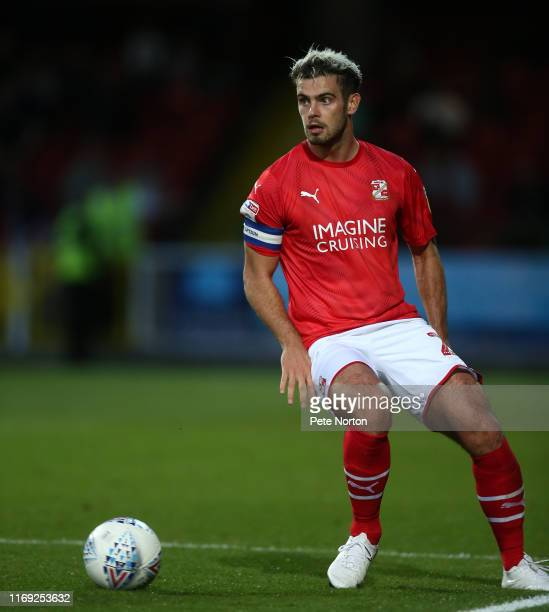 Dion Conroy of Swindon Town in action during the Sky Bet League Two match between Swindon Town and Northampton Town at The County Ground on August...