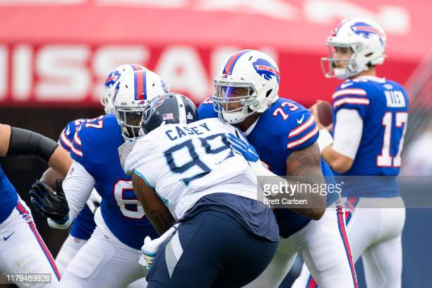 Dion Dawkins of the Buffalo Bills blocks Jurrell Casey of the Tennessee Titans during the first quarter at Nissan Stadium on October 6, 2019 in...