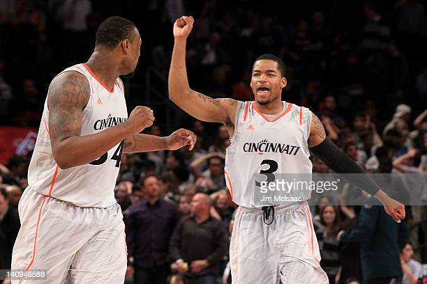 Dion Dixon and Yancy Gates of the Cincinnati Bearcats reacts after defeating the Georgetown Hoyas during the quarterfinals of the Big East Men's...