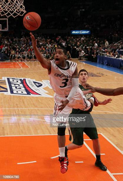Dion Dixon of the Cincinnati Bearcats drives to the basket against Shaun Noriega of the South Florida Bulls during the second round of the 2011 Big...