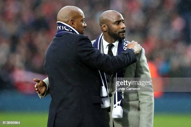 Dion Dublin and Jason Roberts embrace prior to the Premier League match between West Bromwich Albion and Southampton at The Hawthorns on February 3...