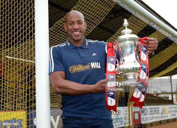 Dion Dublin former Cambridge United and Manchester United player poses with the FA Cup ahead of the the Fourth Round match between Cambridge United...