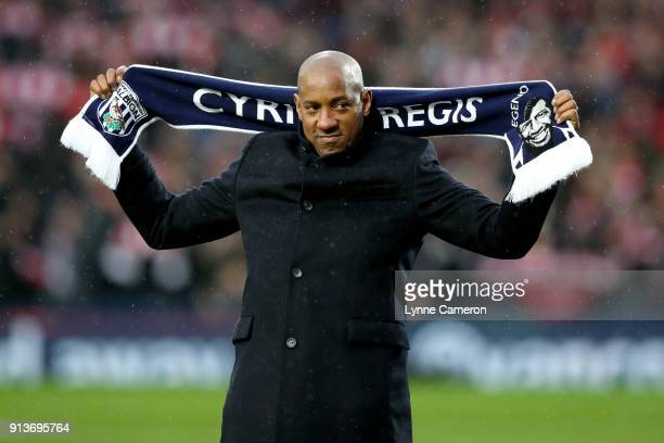 Dion Dublin holds a Cyrille Regis scarf prior to the Premier League match between West Bromwich Albion and Southampton at The Hawthorns on February 3...