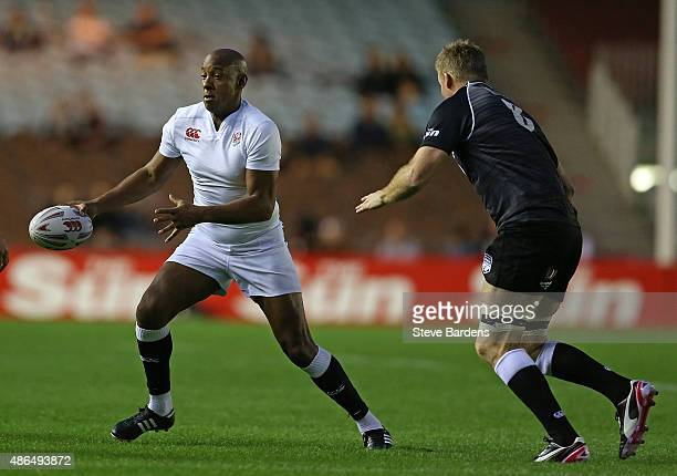 Dion Dublin of England runs wit the ball during the Rugby Aid 2015 celebrity rugby match between England and the Rest of the World at The Stoop on...