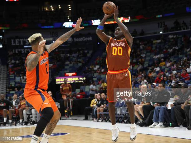 Dion Glover of Bivouac shoots the ball as Andre Emmett of 3's Company defends during the BIG3 Playoffs at Smoothie King Center on August 25, 2019 in...