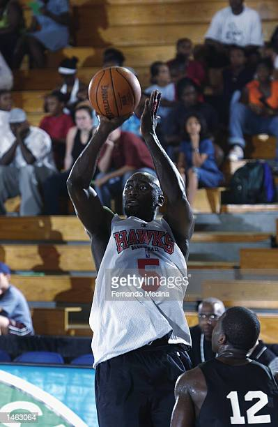 Dion Glover of the Atlanta Hawks shoots over Anthony Goldwire of the San Antonio Spurs during Shaw's Pro Summer League on July 15, 2002 at Clark...