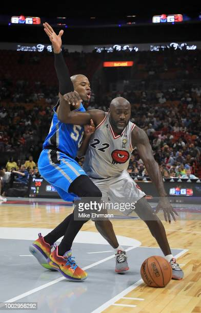 Dion Glover of Trilogy tries to get away from Corey Magette of Power in a game during Big 3Week Five at American Airlines Arena on July 20 2018 in...