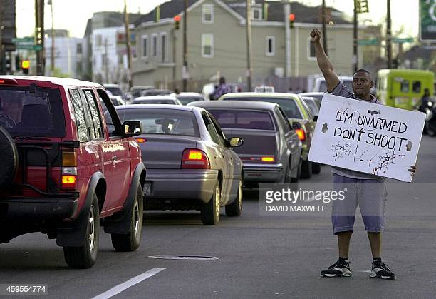 Dion Jackson protests in the street against police violence in the early evening 12 April 2001 in downtown Cincinnati OH Three days of violent civil...