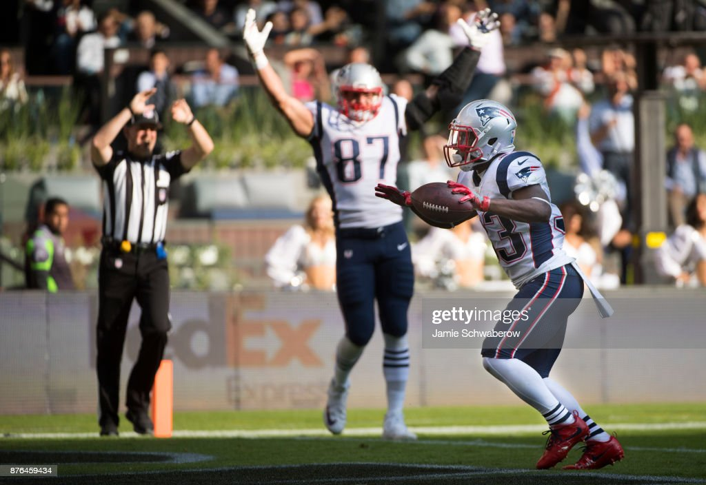 Dion Lewis #33 and Rob Gronkowski #87 of the New England Patriots celebrate a touchdown against the Oakland Raiders at Estadio Azteca on November 19, 2017 in Mexico City, Mexico.