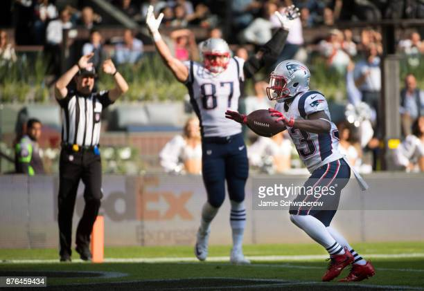 Dion Lewis and Rob Gronkowski of the New England Patriots celebrate a touchdown against the Oakland Raiders at Estadio Azteca on November 19 2017 in...