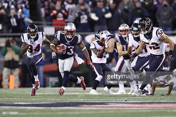 Dion Lewis of the New England Patriot runs the ball for a 98yard kick off return touchdown against the Houston Texans during the AFC Divisional...