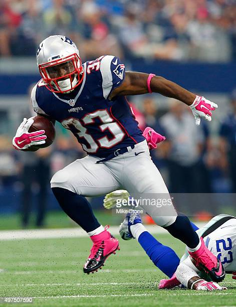 Dion Lewis of the New England Patriots carries the ball against the Dallas Cowboys during the NFL game at ATT Stadium on October 11 2015 in Arlington...