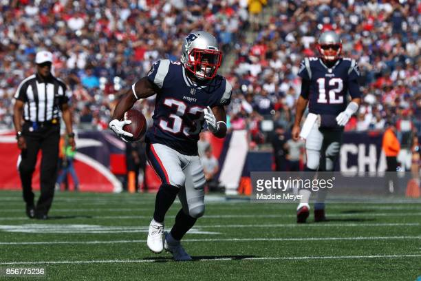 Dion Lewis of the New England Patriots carries the ball against the Carolina Panthers at Gillette Stadium on October 1 2017 in Foxboro Massachusetts