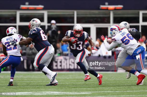 Dion Lewis of the New England Patriots carries the ball against the Buffalo Bills at Gillette Stadium on December 24 2017 in Foxboro Massachusetts