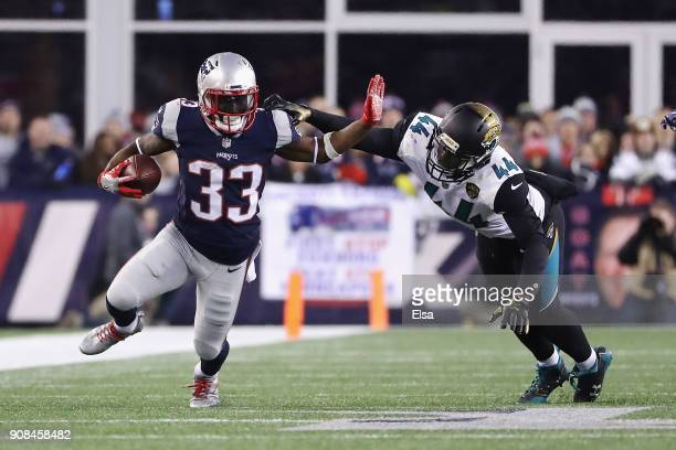 Dion Lewis of the New England Patriots carries the ball as he is defended by Myles Jack of the Jacksonville Jaguars in the third quarter during the...