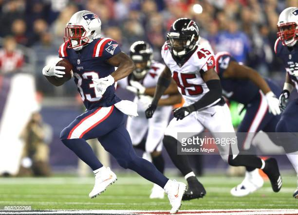 Dion Lewis of the New England Patriots carries the ball during the second quarter of a game against the Atlanta Falcons at Gillette Stadium on...