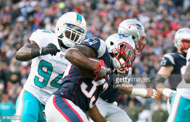 Dion Lewis of the New England Patriots carries the ball during the first quarter of a game against the Miami Dolphins at Gillette Stadium on November...