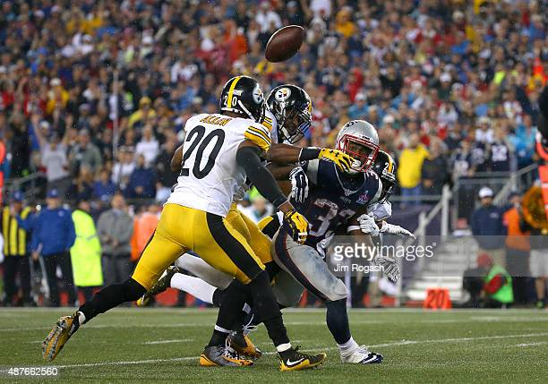 Dion Lewis of the New England Patriots has the ball stripped by Mike Mitchell of the Pittsburgh Steelers in the second half at Gillette Stadium on...