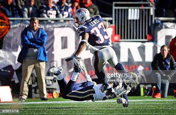 Dion Lewis of the New England Patriots is tackled by Maurice Alexander of the Los Angeles Rams during the first half of a game at Gillette Stadium on...