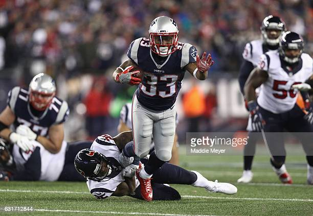 Dion Lewis of the New England Patriots is tackled in the second half against the Houston Texans during the AFC Divisional Playoff Game at Gillette...