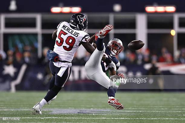 Dion Lewis of the New England Patriots misses a catch while under pressure by Whitney Mercilus of the Houston Texans in the first half against the...