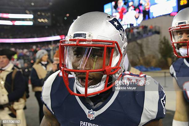 Dion Lewis of the New England Patriots reacts after running the ball for a 98yard kick off return touchdown against the Houston Texans during the AFC...