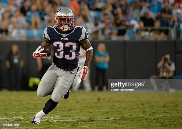 Dion Lewis of the New England Patriots runs against the Carolina Panthers during their preseason NFL game at Bank of America Stadium on August 28...