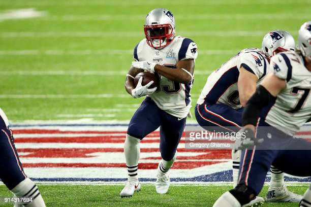Dion Lewis of the New England Patriots runs the ball against the Philadelphia Eagles during the second quarter in Super Bowl LII at US Bank Stadium...