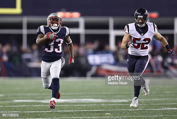 Dion Lewis of the New England Patriots runs the ball for a 98yard kick off return touchdown against the Houston Texans during the AFC Divisional...