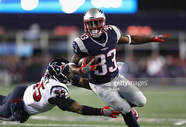 Dion Lewis of the New England Patriots runs the ball past Benardrick McKinney of the Houston Texans for a touchdown in the first quarter during the...