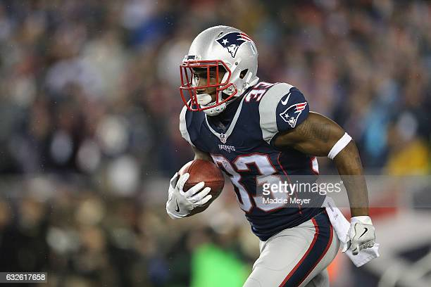 Dion Lewis of the New England Patriots runs with the ball against the Pittsburgh Steelers in the AFC Championship Game at Gillette Stadium on January...