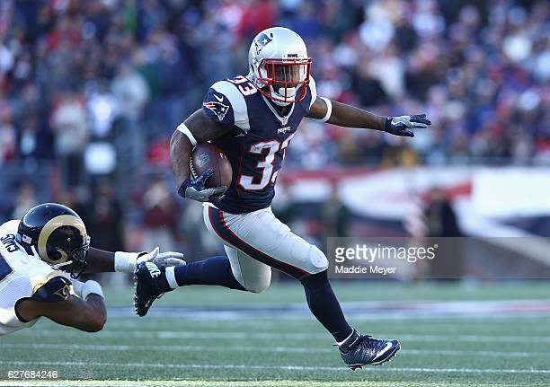 Dion Lewis of the New England Patriots runs with the ball during the first half against the Los Angeles Rams at Gillette Stadium on December 4 2016...
