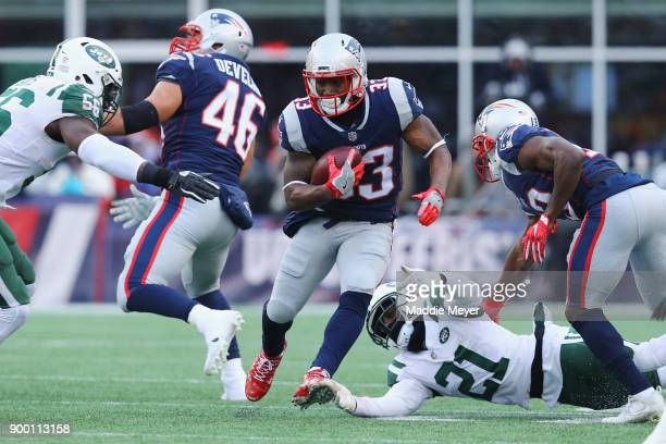 Dion Lewis of the New England Patriots runs with the ball during the second half against the New York Jets at Gillette Stadium on December 31 2017 in...