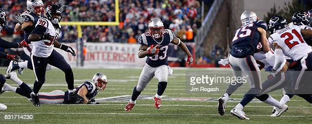 Dion Lewis of the New England Patriots runs with the ball in the second half against the Houston Texans during the AFC Divisional Playoff Game at...