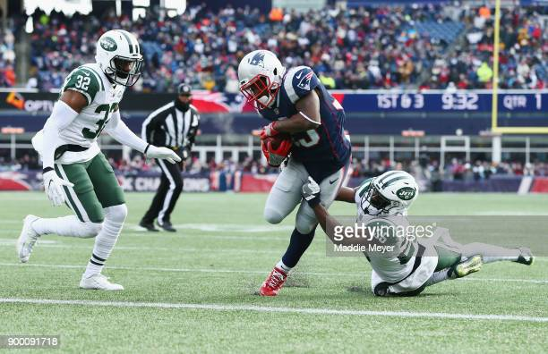 Dion Lewis of the New England Patriots rushes for a 3yard touchdown during the first quarter against the New York Jets at Gillette Stadium on...