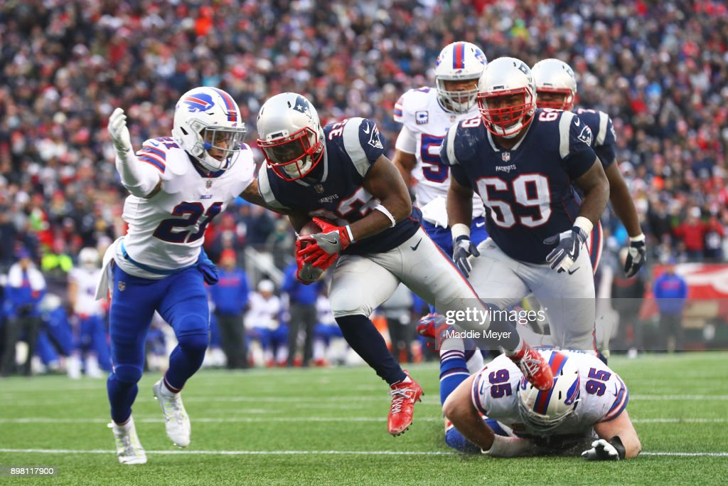 Dion Lewis #33 of the New England Patriots scores a touchdown against the Buffalo Bills during the first half at Gillette Stadium on December 24, 2017 in Foxboro, Massachusetts.