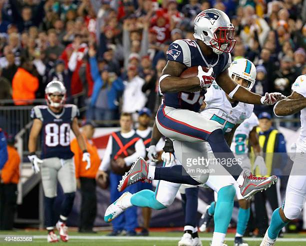 Dion Lewis of the New England Patriots scores a touchdown during the second quarter against the Miami Dolphins at Gillette Stadium on October 29 2015...
