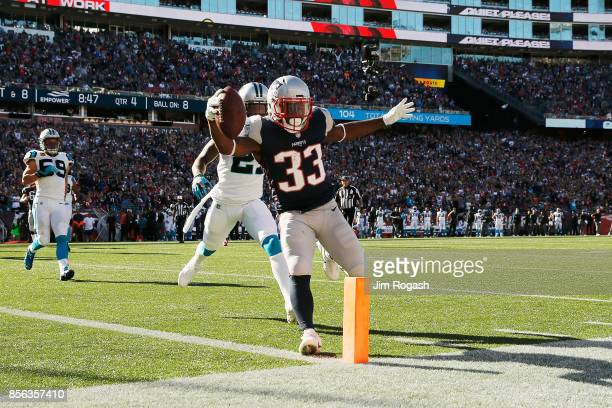 Dion Lewis of the New England Patriots scores a touchdown during the fourth quarter against the Carolina Panthers at Gillette Stadium on October 1...