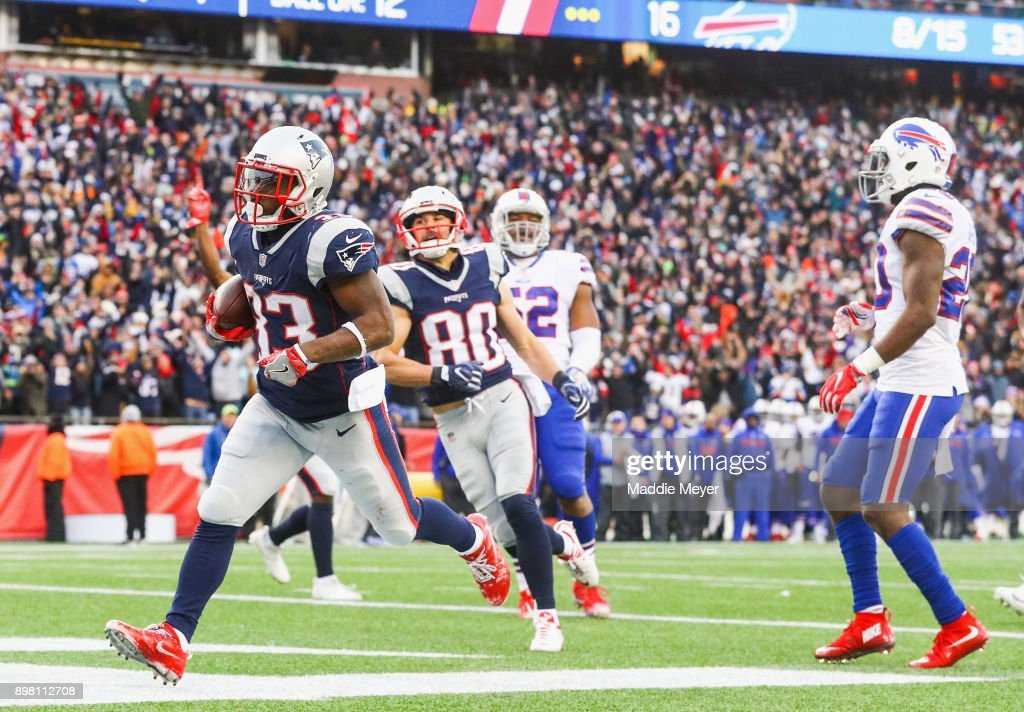 Dion Lewis #33 of the New England Patriots scores a touchdown during the fourth quarter of a game against the Buffalo Bills at Gillette Stadium on December 24, 2017 in Foxboro, Massachusetts.
